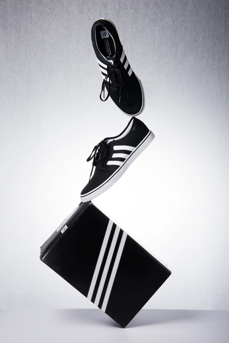 Balancing Adidas Sneakers and Shoebox