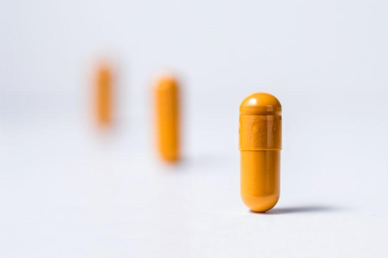 standing yellow pills