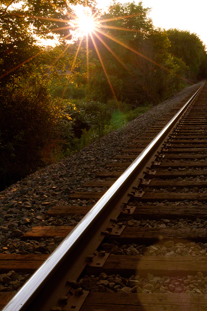 mindfulness in photography train tracks before sunset
