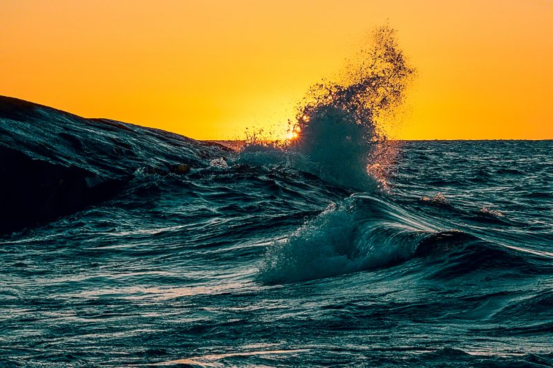 Lake superior waves during sunrise with sunstar