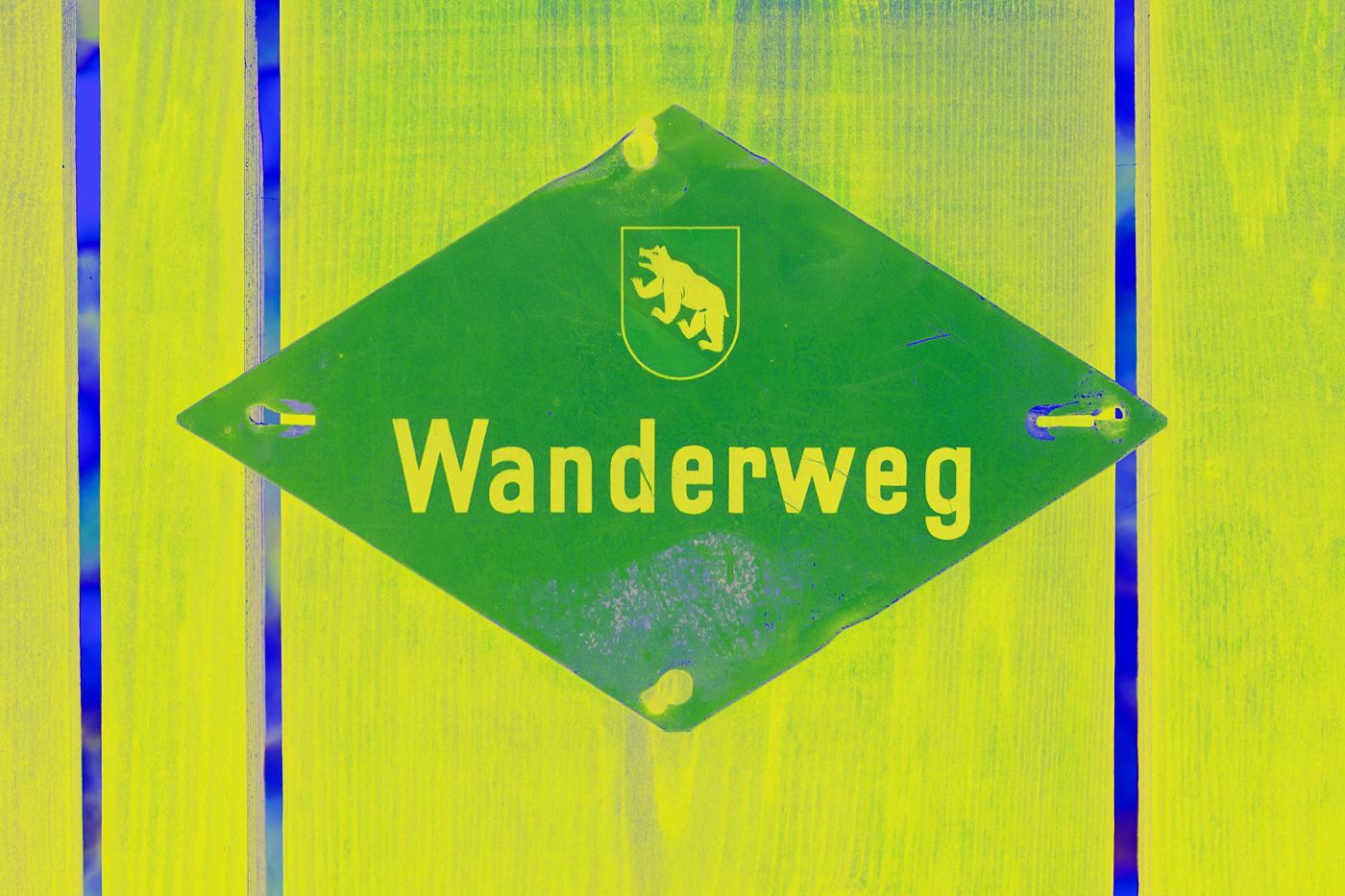 hiking sign switzerland yellow