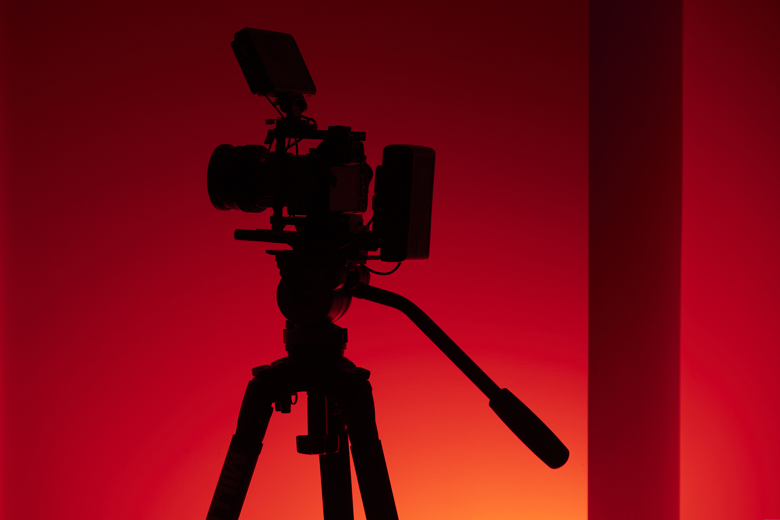 video camera rig silhouette on red background