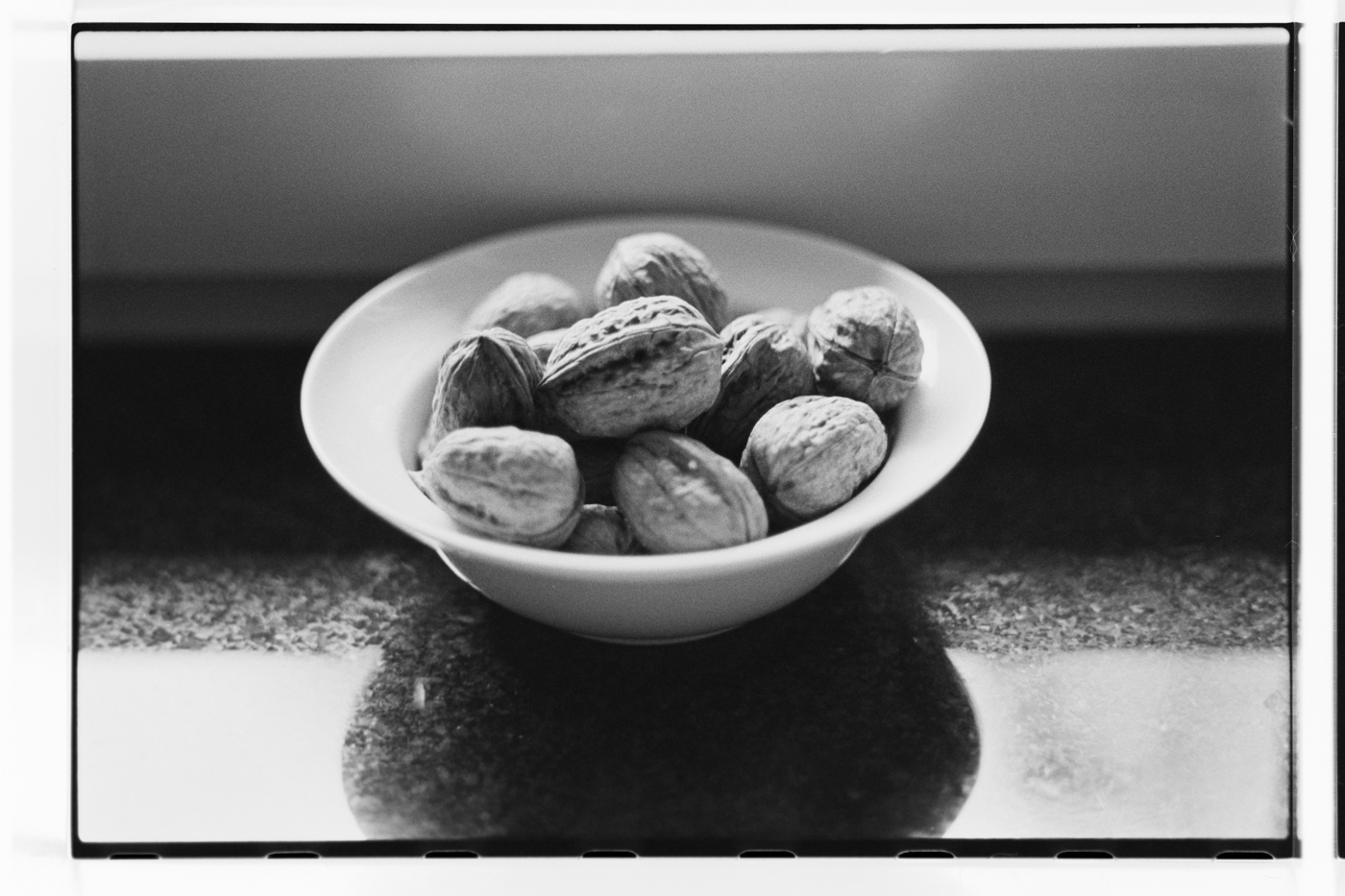 walnuts on plate black and white still life