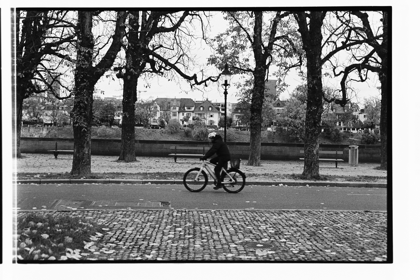 byciclist in Basel close to Rhein river