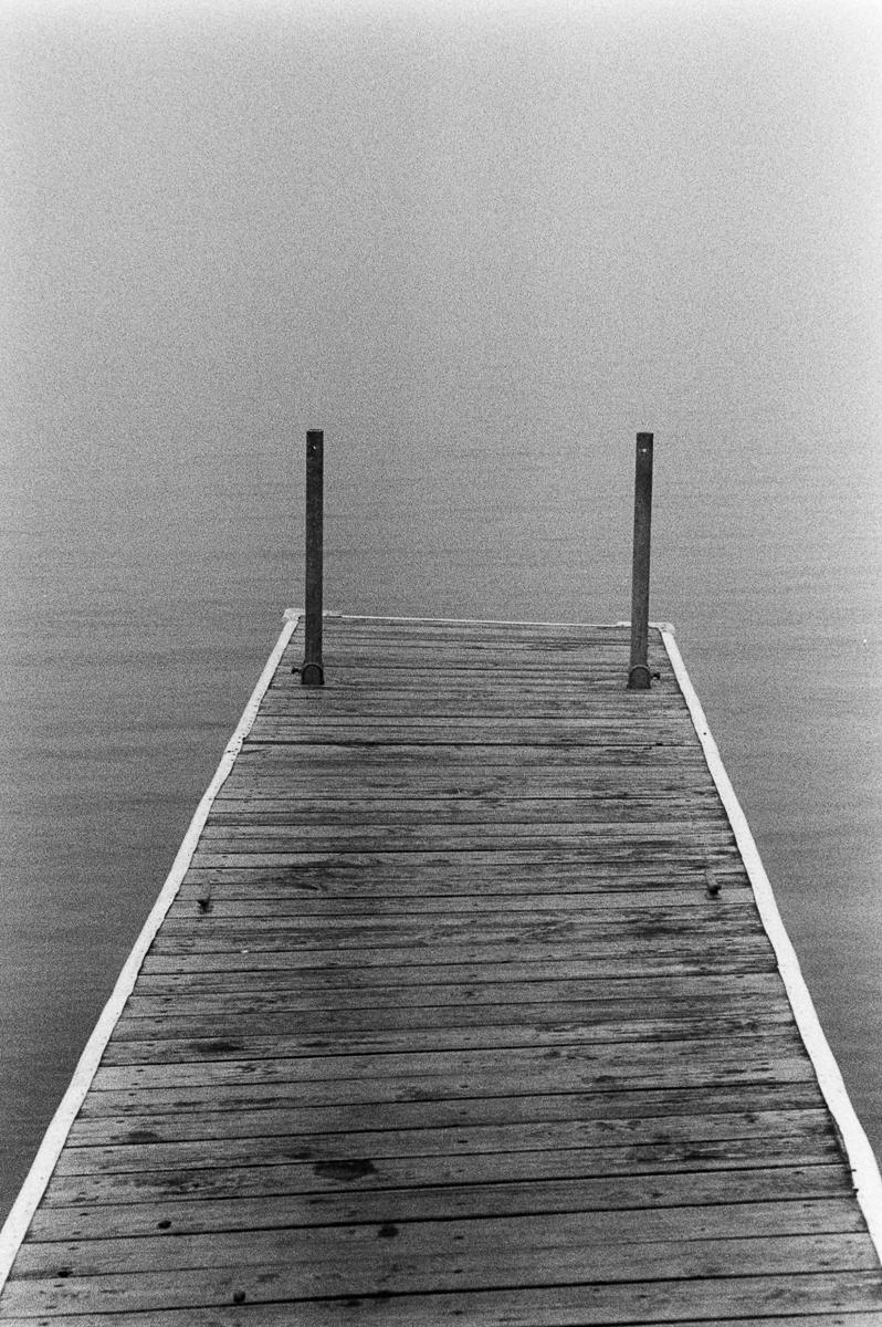 pier in the fog lake superior black and white trix 400 kodak