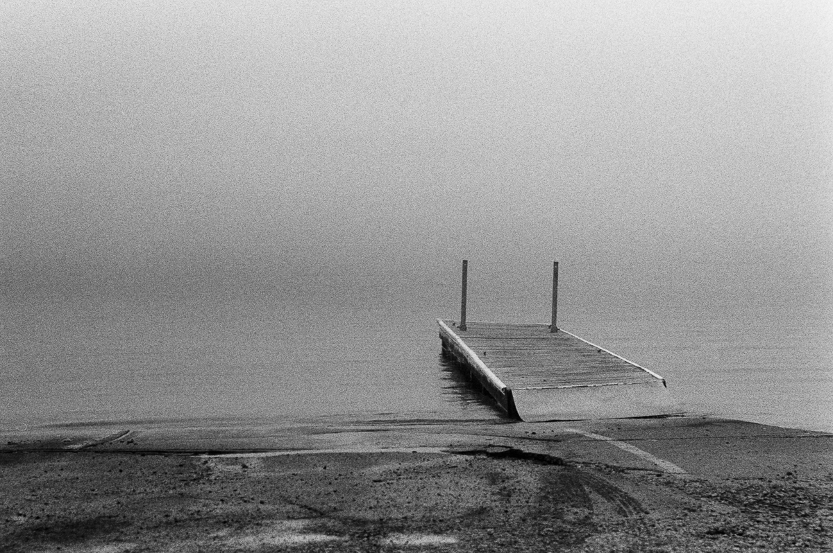 pier in the fog lake superior black and white trix kodak